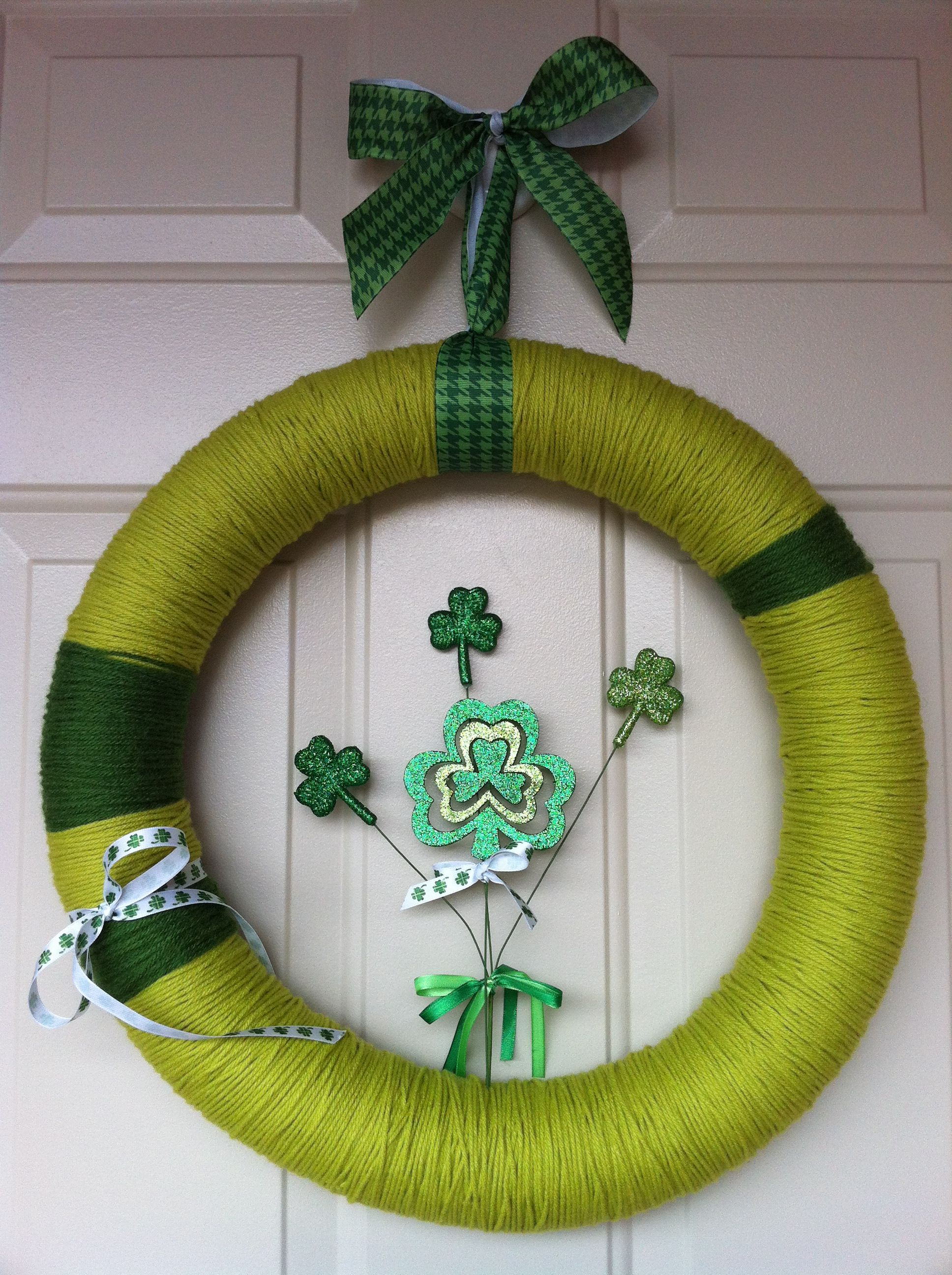 My newest festive wreath that I made to celebrate my Irish Heritage (and for St. Patrick's Day)...made from a pool noodle, yarn, ribbon and St. Patty's Day deco! #poolnoodlewreath