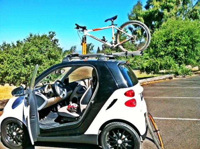 Smart Four Two Featuring A Thule Rooftop Bike Rack