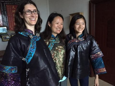 Maria Franzini_ Hong Lin_ and Celina Luo tried on traditional Buyi jackets.