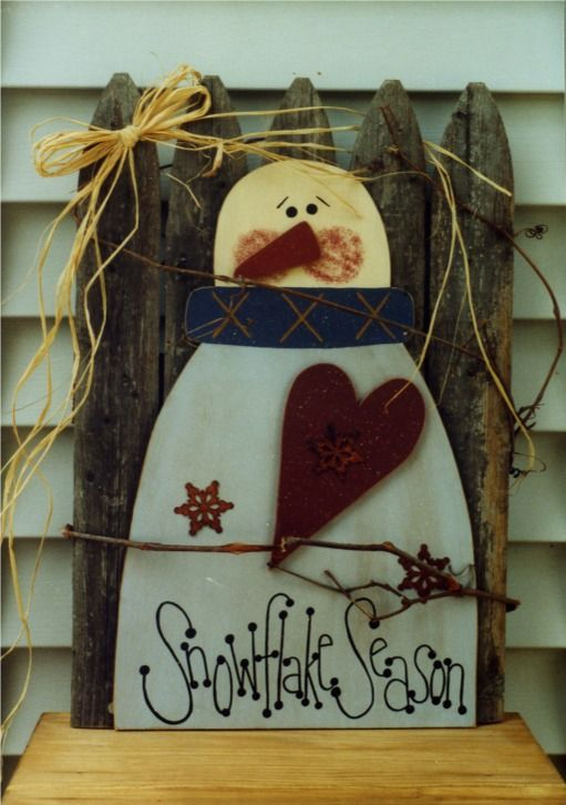 """SNOWFLAKE SEASON Quick & easy snowman to decorate your porch or yard! This guy measures a big 12"""" wide by 20"""" tall (without the fence)! Great piece to add to a large wreath, attach it to a piece of old fence (as shown) or you can add a stake or base - whatever you like!"""