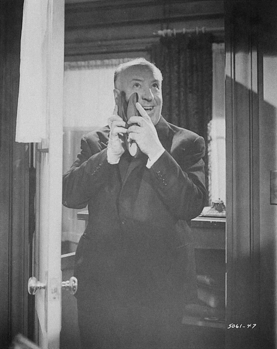 Director Alfred Hitchcock on the set of Psycho, 1960.