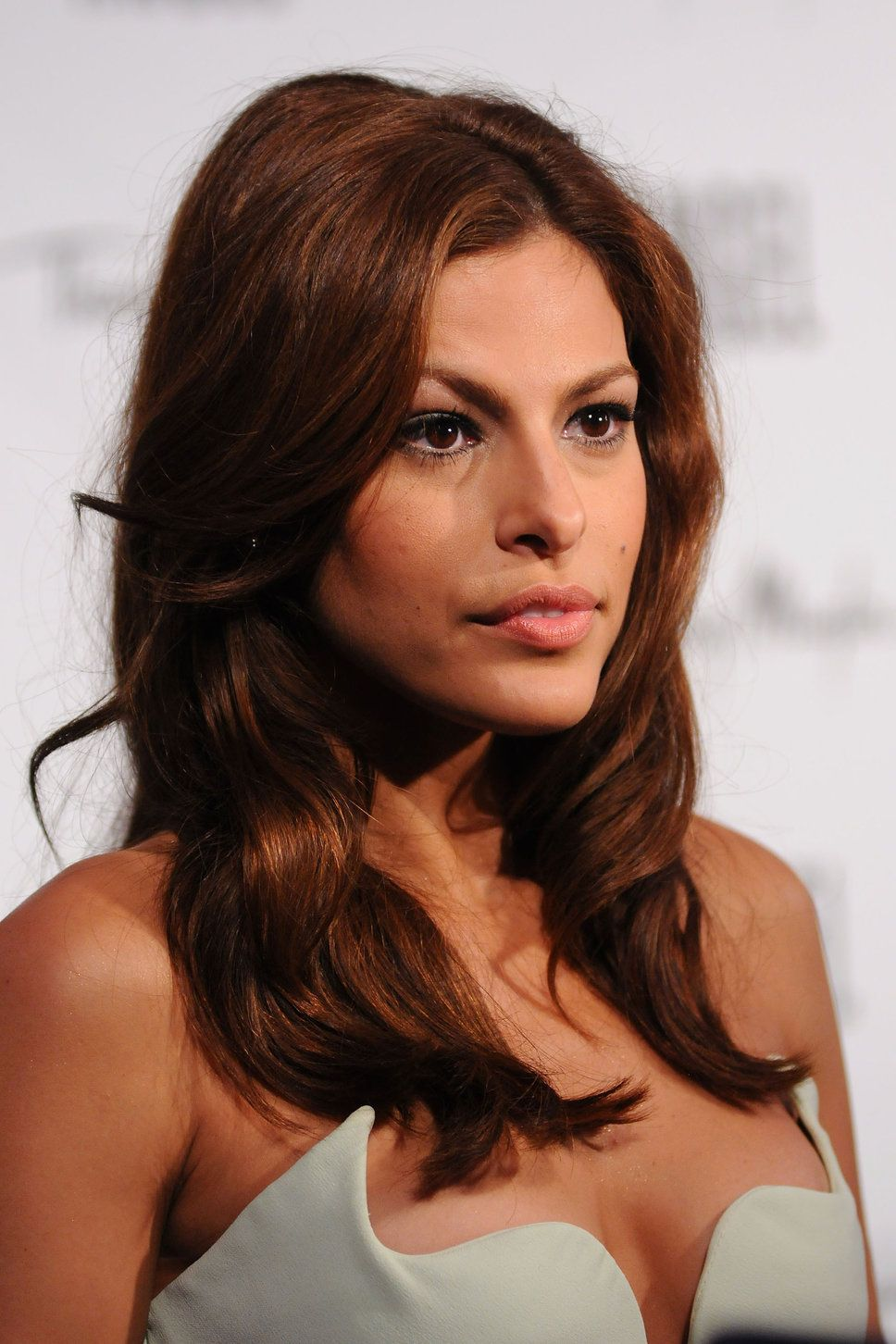 Hair color for dark skin tone - This Rich Medium Brown Hair Color Complements Eva Mendes Tan Skin Tone For A