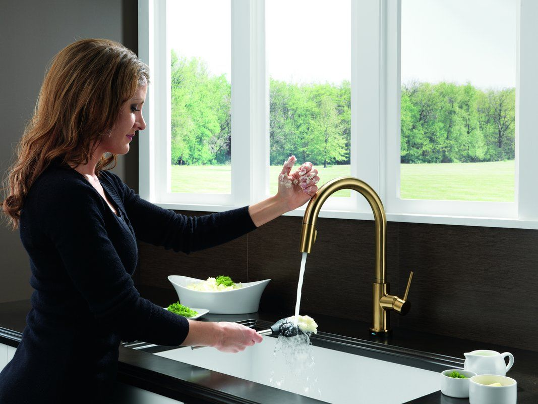 This champagne bronze Delta faucet adds a touch of elegance to your ...