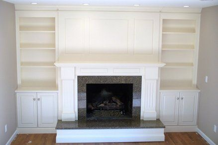 Fireplace Surround With Shelving And Cabinets Wish We Could Do This Fireplace Surrounds Small Basement Remodel Basement Remodeling