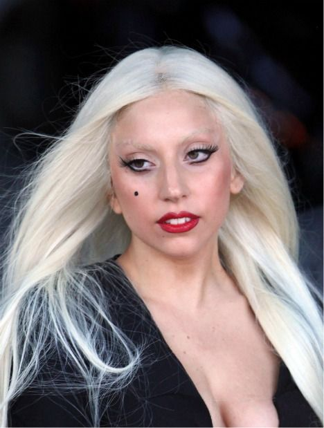Lady Gaga With Platinum Long Blonde Hair Red Lips Faux Beauty Mark And Very Winged Liner Side Swept Hairstyles Bleached Hair Long Blonde Hair