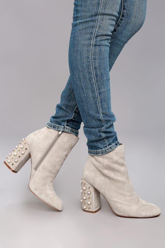 Make the sidewalk your runway in the Steve Madden Yvette Taupe Suede  Leather Studded Booties!