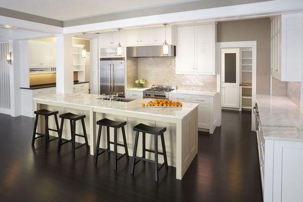 white shaker cabinets dark wood flooring stainless steel