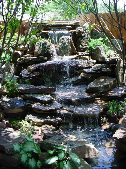 Stone tiers create water music garden ponds water for Koi pond music