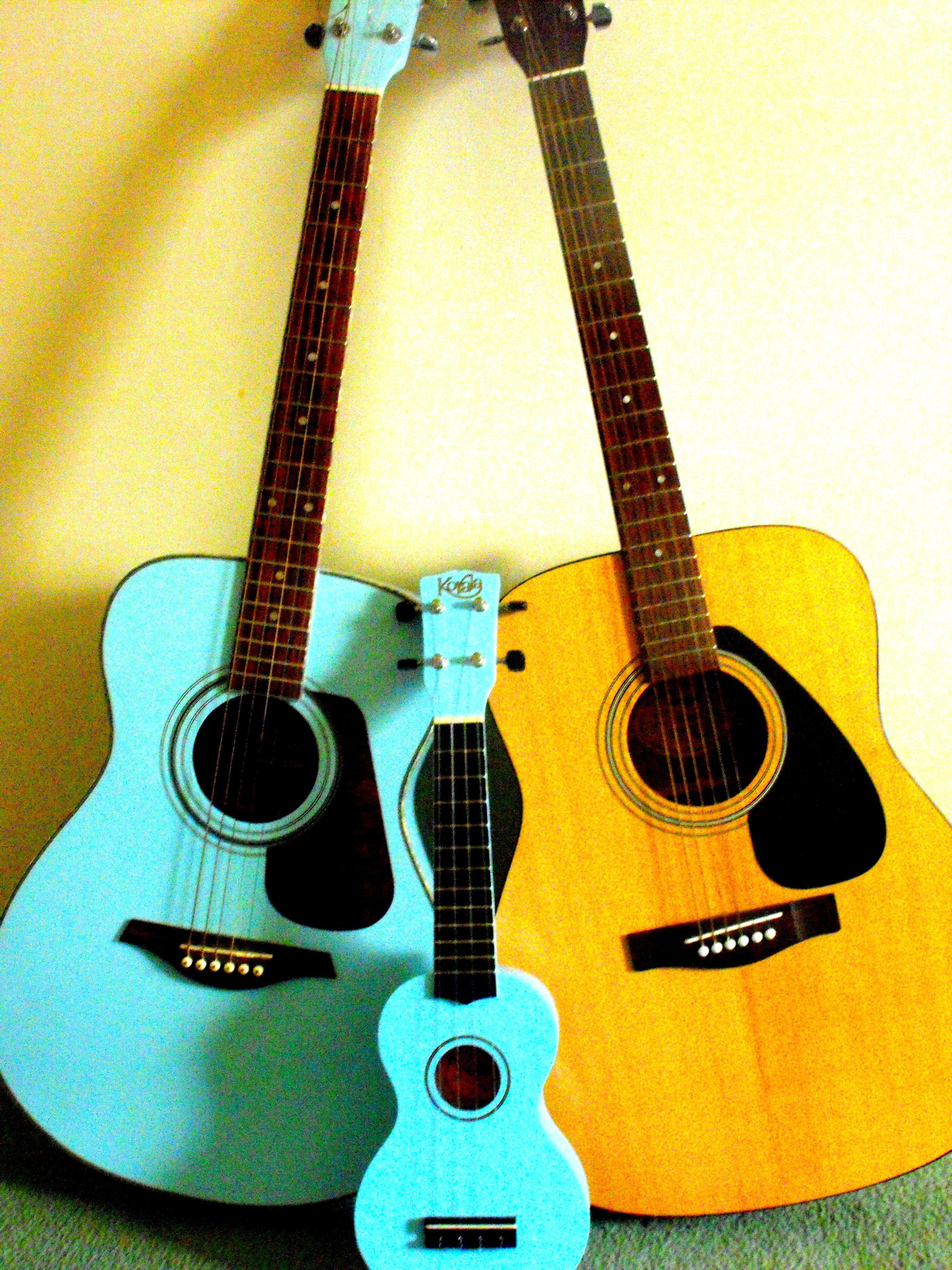 Mummy guitar daddy guitar and baby ukulele guitar