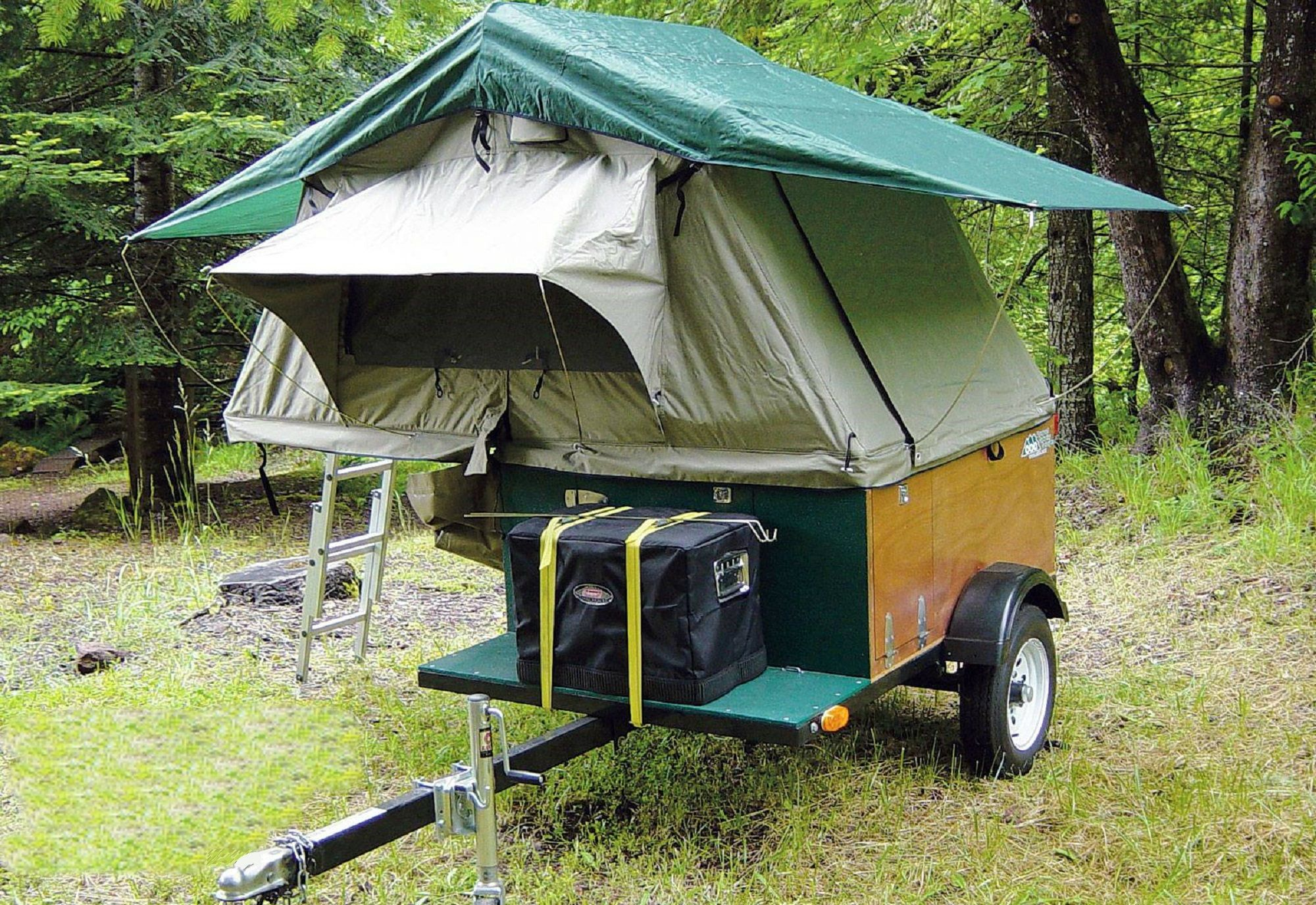Compact Trailer Tent Camping Explorer Box.    http://compactcampingconcepts.com and/or http://rvmagonline.com/buyers-guide/0812rv-tent-camper-trailers/photo_31.html