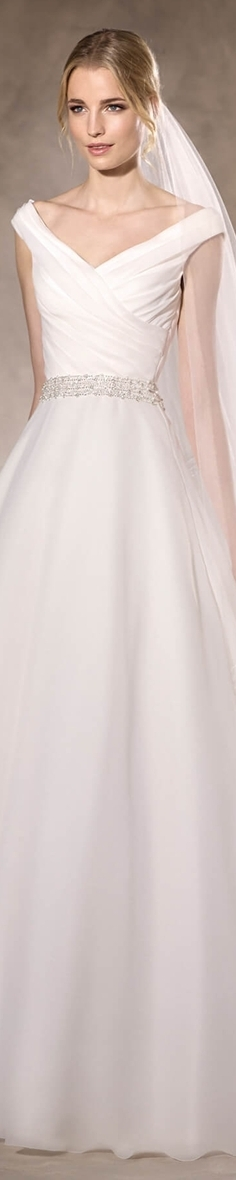 La Sposa Bridal 2017 Hajar Elegant A-line wedding dress in garza, with a beautiful draped bodice also in garza and delicate gemstones that encircle the waist.