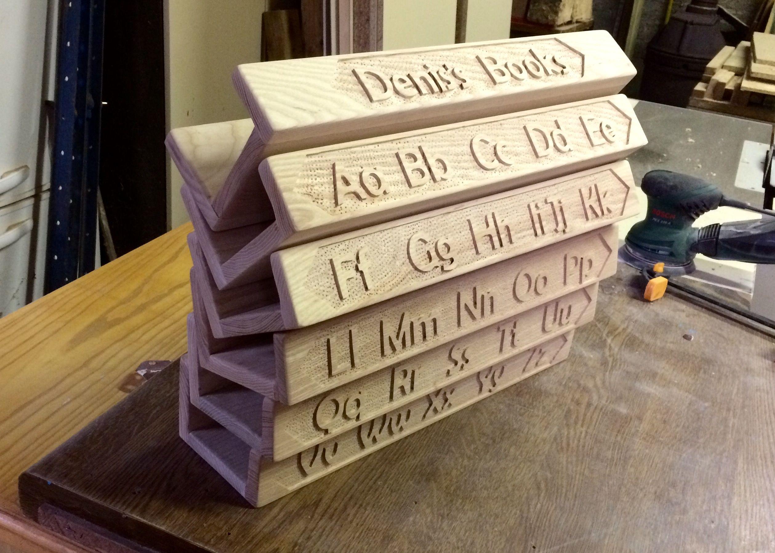 Alphabet carved book shelves in Irish Ash.
