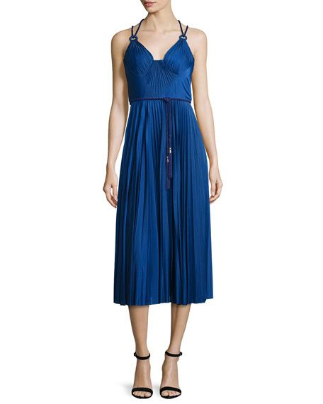 "Catherine Deane pleated cocktail dress. Approx. length: 50""L from shoulder to hem, 34""L down center back. V neckline with halter illusion. Sleeveless; double straps. Cord belt wraps waist. Strappy cro"