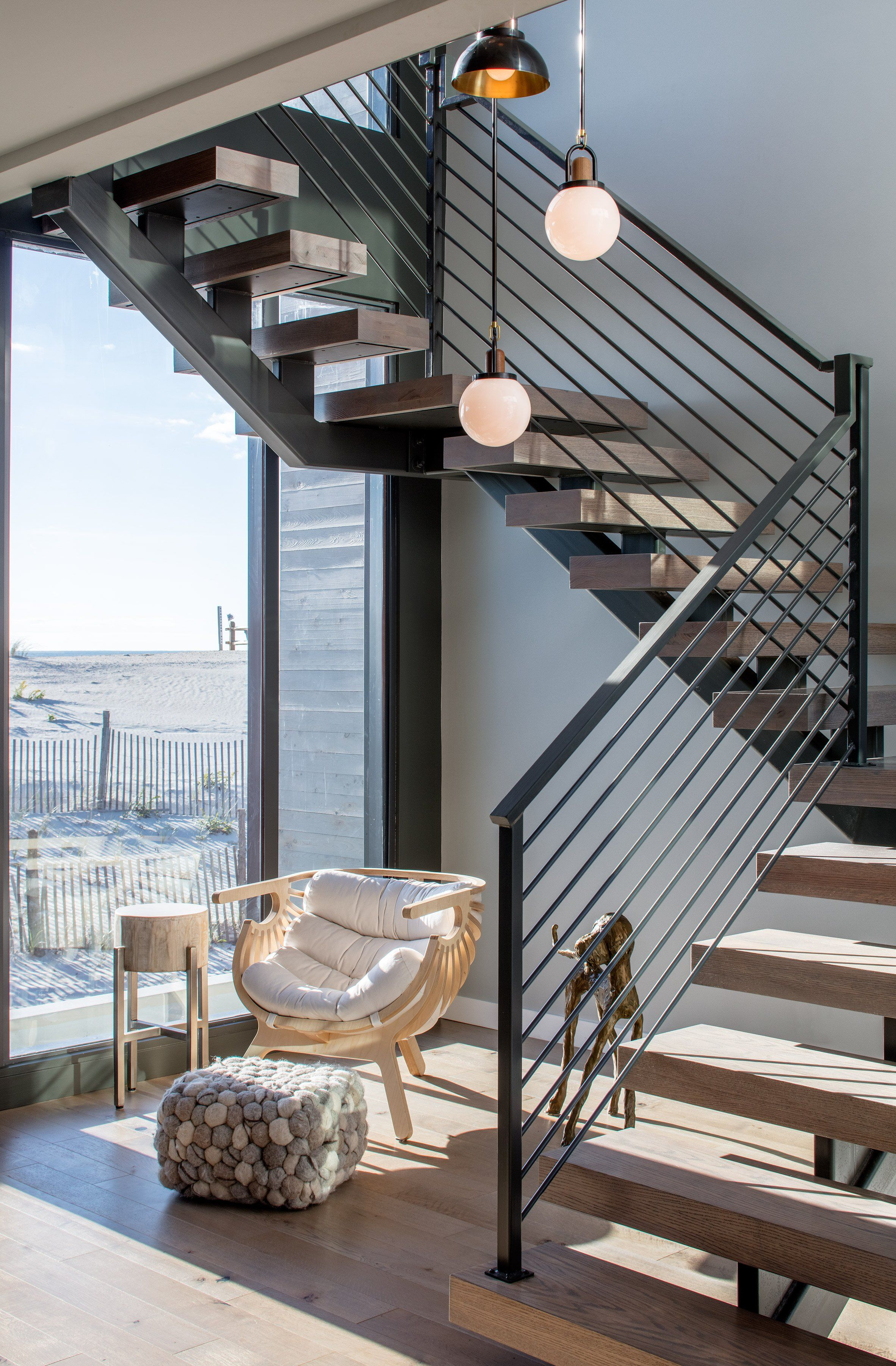 Home interior stairs specht architects constructs lofty beach haven residence in new
