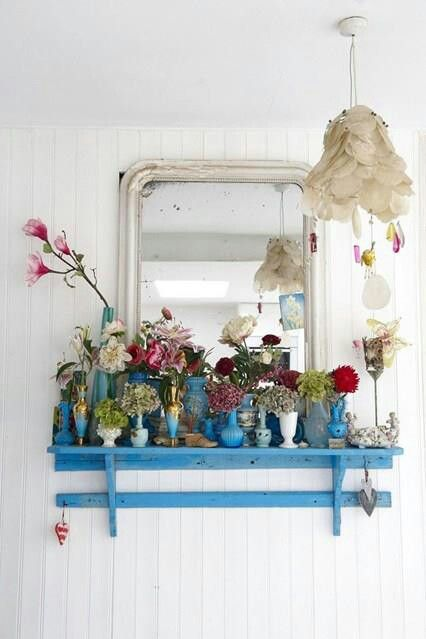Vase cluster on a shelf, just imagine a claw foot tub beside it