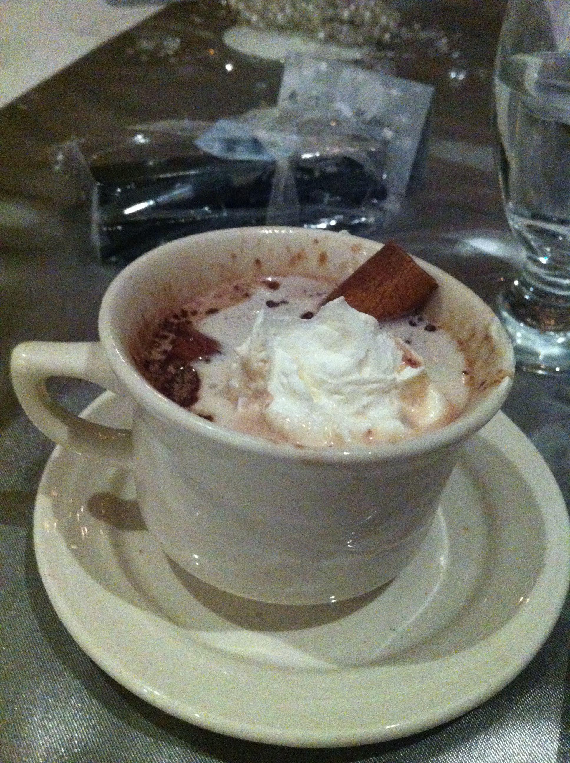 Hot chocolate whipped cream and cinnamon eat hot