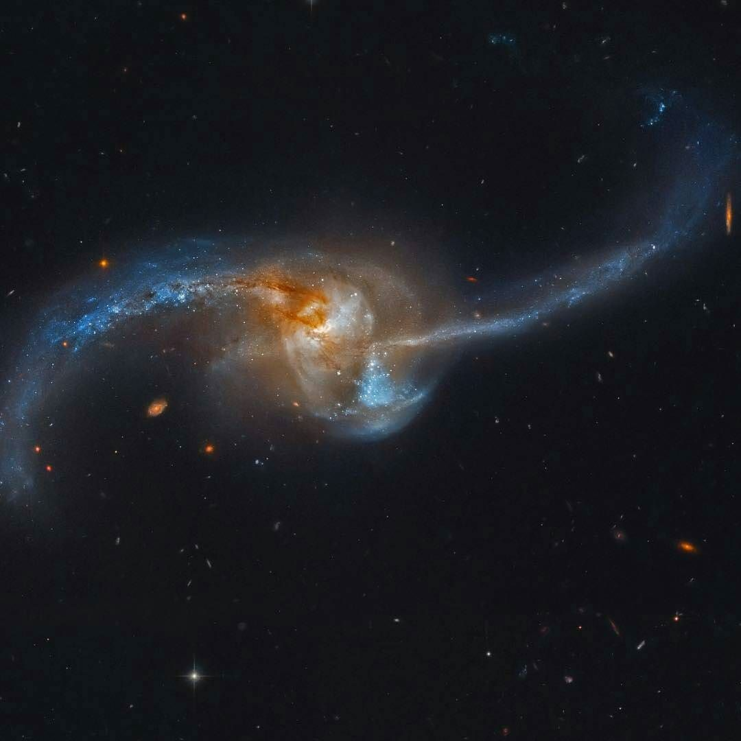 On instagram by origin_of_spacetime  #astrophotography #metsuke (o)  http://ift.tt/1NyDZAW  NGC 2623 is really two galaxies that are becoming one. Seen to be in the final stages of a titanic galaxy merger the pair lies some 300 million light-years distant toward the constellation Cancer. The violent encounter between two galaxies that may have been similar to the Milky Way has produced widespread star formation near a luminous core and along eye-catching tidal tails. Filled with dust gas and…