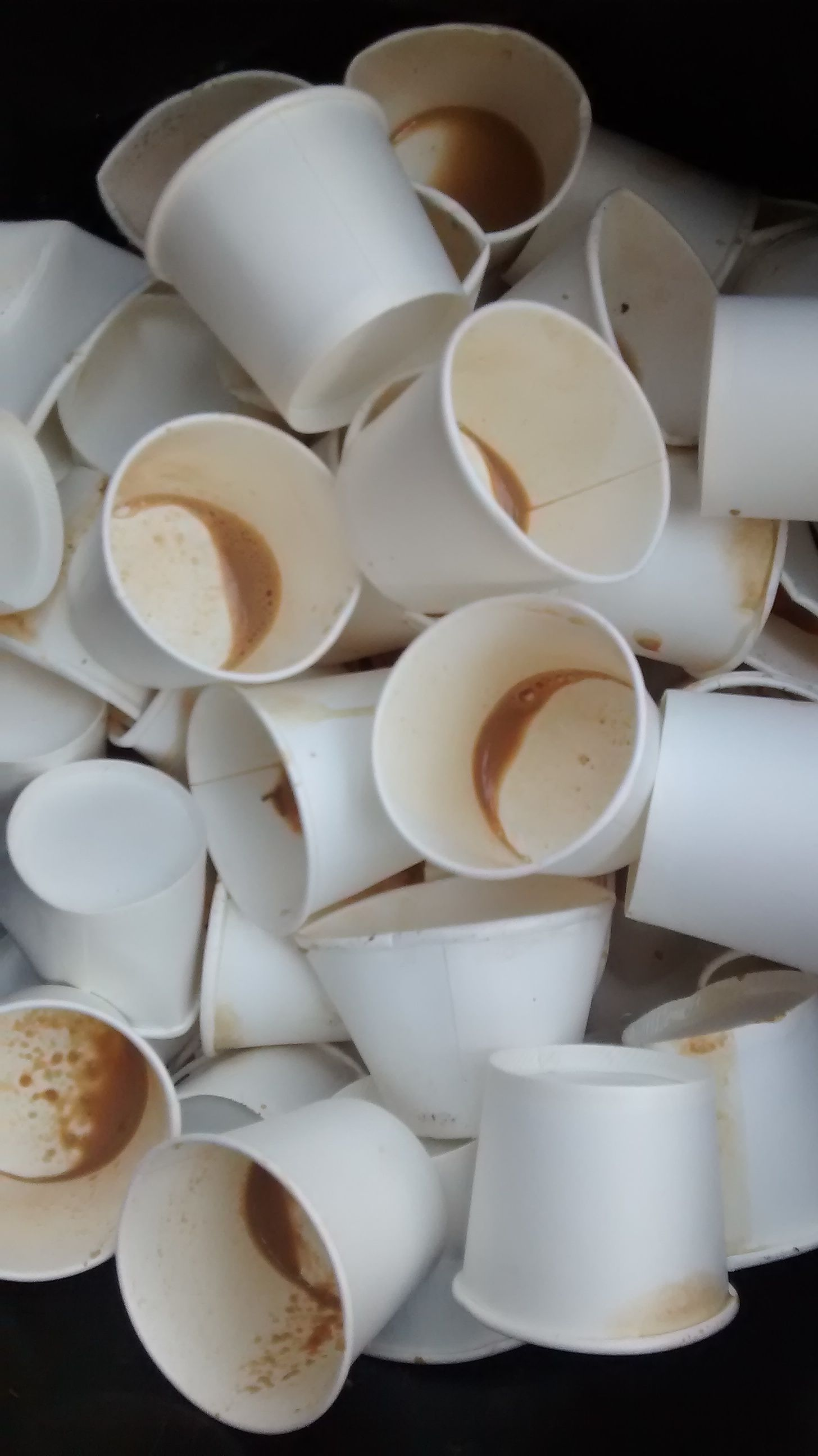 used cups in dustbin