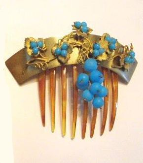"""Victorian Algerian ornament with a brass tiara, turquoise leaves, and a turquoise pendant attached to a horn comb. Gift given to Jenny Lind by a """"Mrs. Wright"""". Jenny Lind performed for Kings and Queens in the late 1800's. The Frances Wright Collection. Photograph by Terry Wright."""