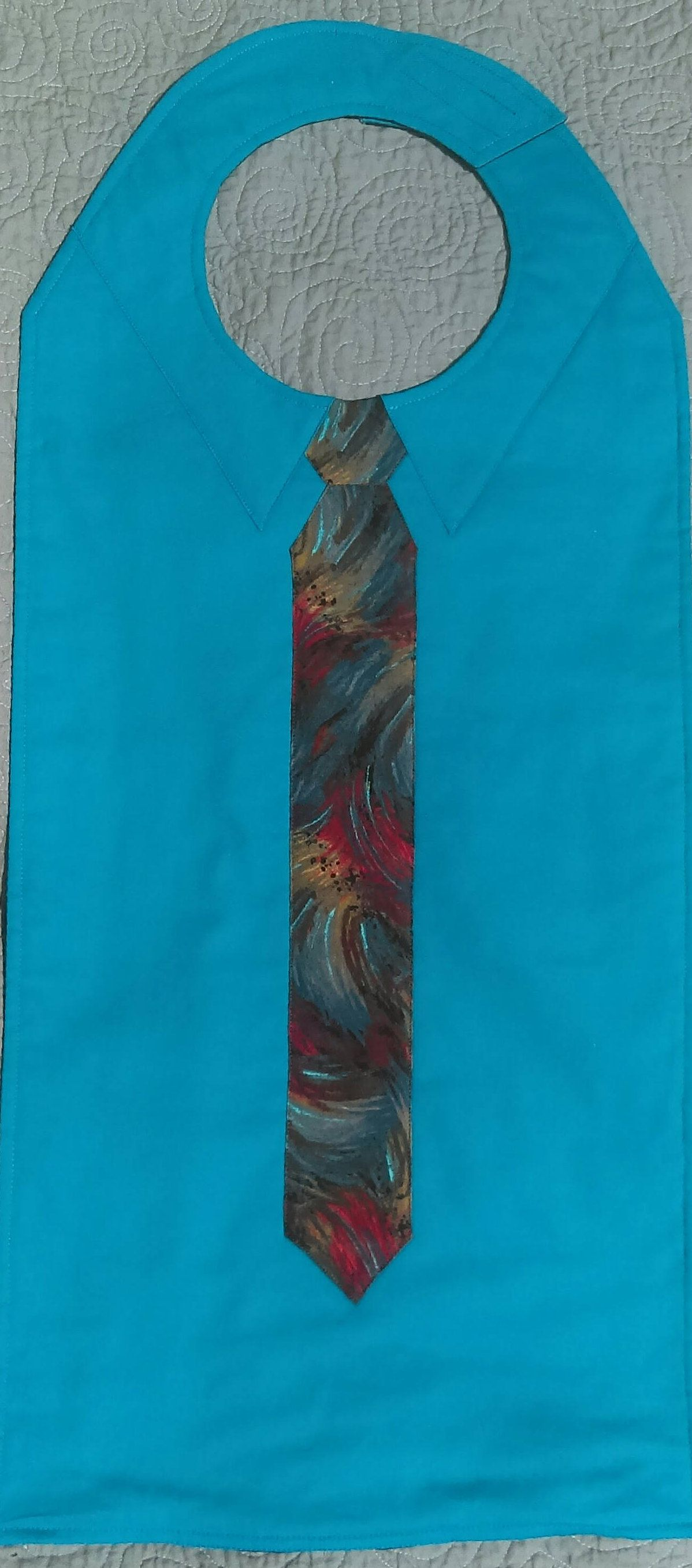 Adult Bib for a Man in Aqua with Snazzy Art Tie for Handsome Dignity