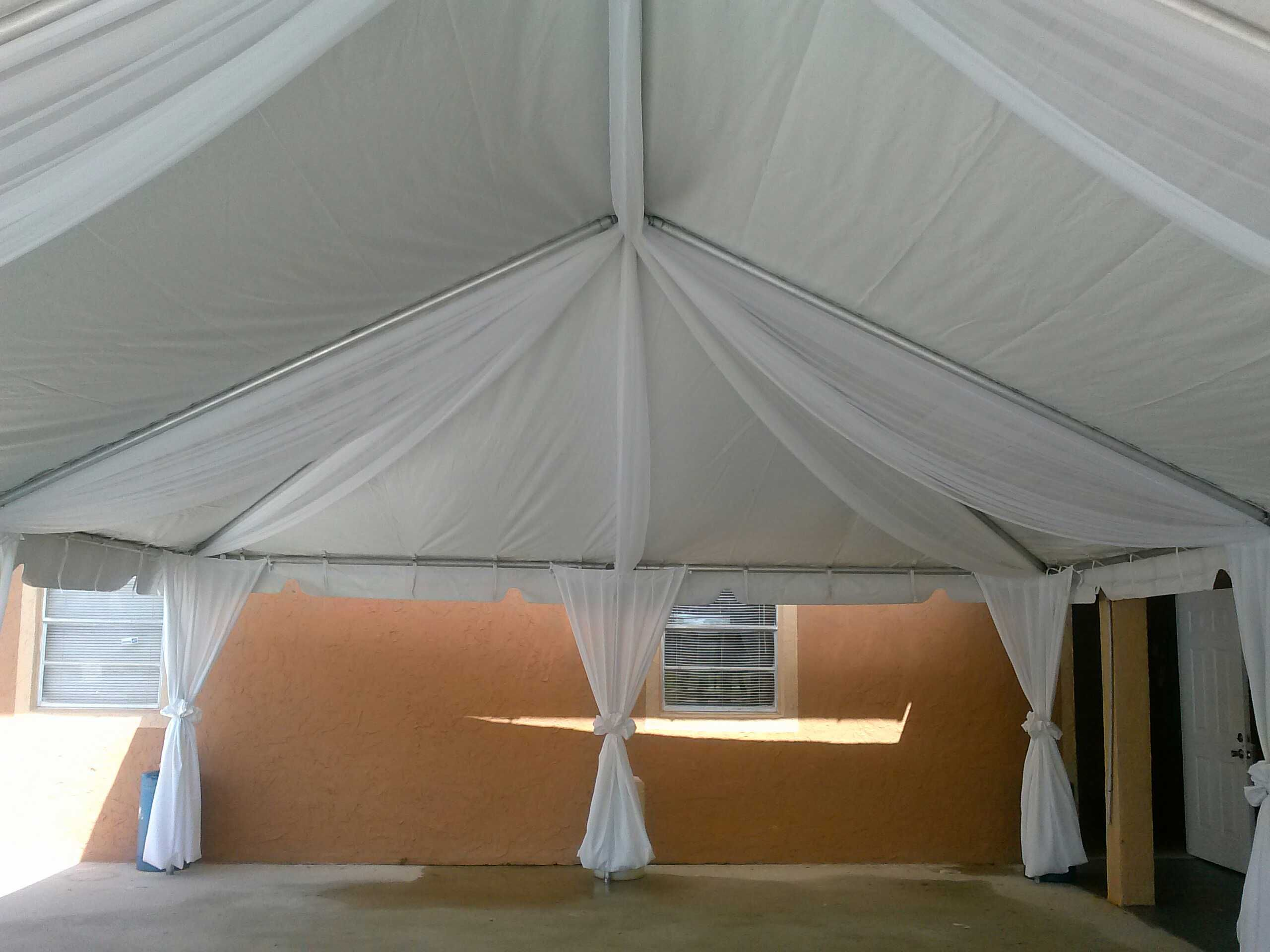 A 20 X 30 Frame Tent With White Drapes
