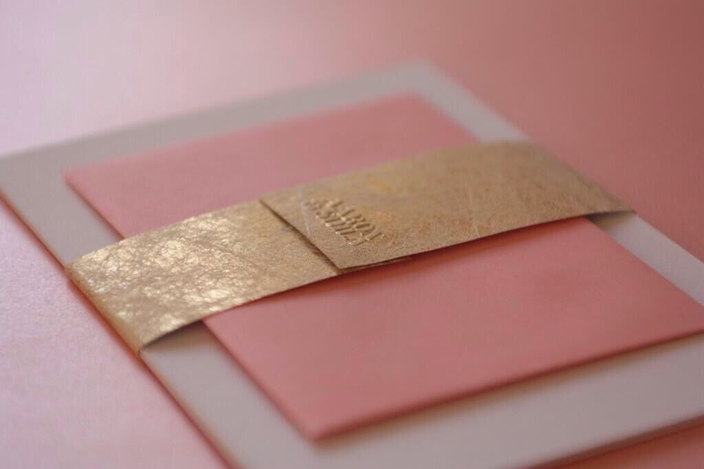 Wedding invitation. Gold twist embossed belly band. Rose gold foil ...