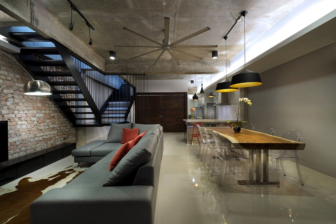 Open plan terrace house interior designed in a stylish industrial ...