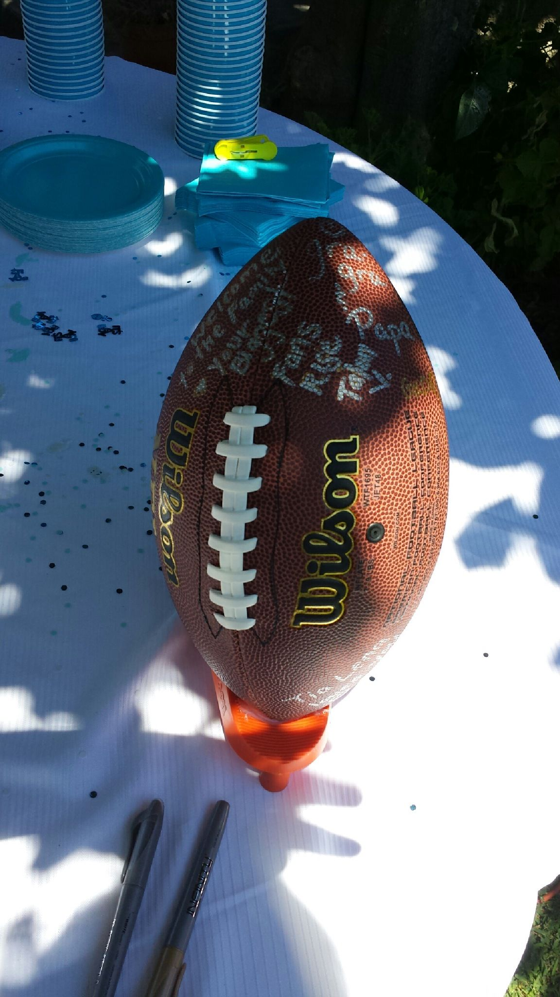 Guest sign football for football themed baby shower