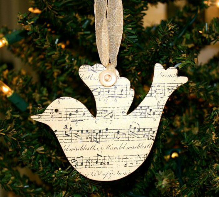10 sheet music Christmas ornaments to make - dove pictured - 10 Beautiful Sheet Music Christmas Ornaments You Can Make Yourself