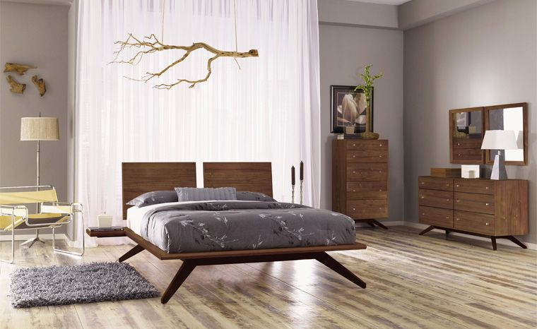 """Astrid Platform Bed. With its deeply splayed legs producing dramatic cantilevers, the Astrid Bedroom is an engineering feat that defies expectations and inspires a sense of possibility. A true platform bed, Astrid may be ordered without or with 1 or 2 headboard panels. Recommended mattress thickness is 8"""" to 12"""". The collection is crafted in solid cherry hardwood and is Made to Order in several finishes."""