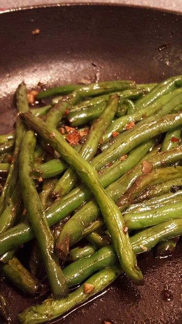 Asian green beans. 1 lb fresh green beans steamed, 3 garlic cloves minced, 2 tbs soy sauce, 2 tbs oyster sauce, salt and pepper to taste. Saute all ingredients in a bit of olive oil until cooked through.