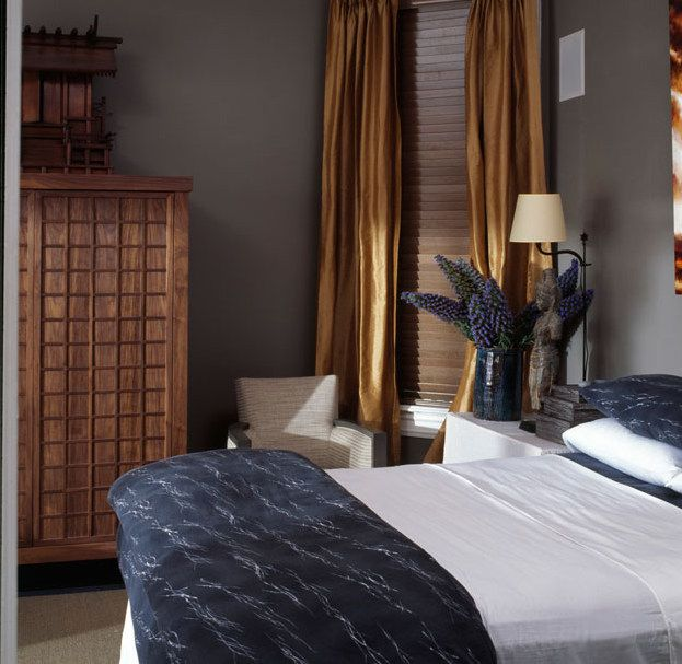 A Modern Bedroom With Grey Walls, Gold Curtains, Touches Of Grey Blue And  An Asian Influence.
