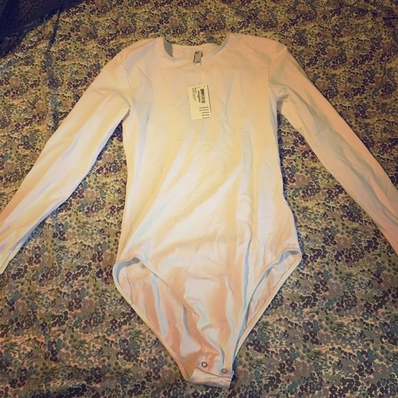 American Apparel body suit Long sleeve, white body suit with button crotch closure American Apparel Other