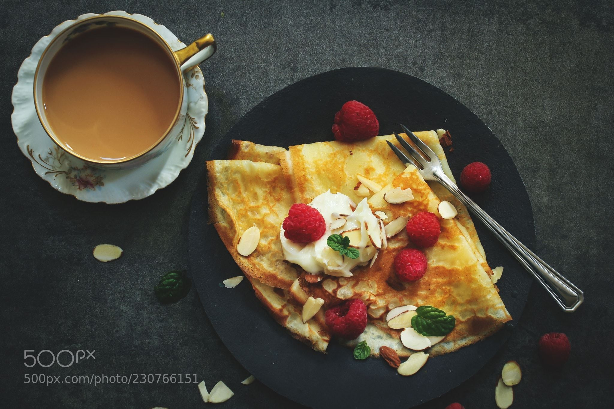 French Breakfast Crepes served with Raspberries  on dark moody background,Top Down view (Vrinda Mahesh / West Chester / USA) #Canon EOS 60D #food #photo #delicious