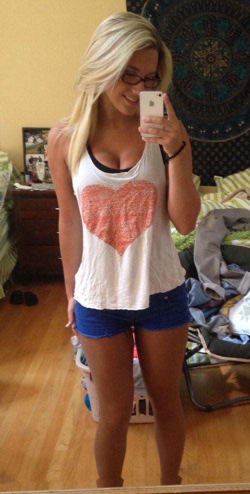 Hot blonde girl mirror selfie