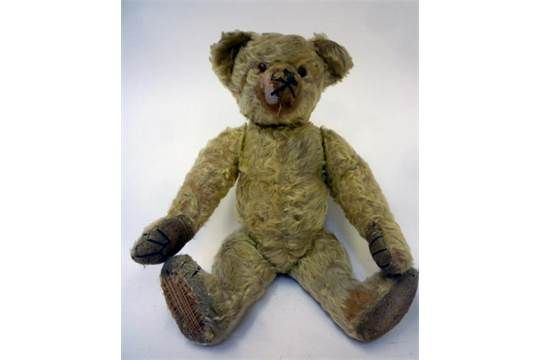 A Farnell teddy bear, c.1930, with swivel joints, covered in gold plush, black/amber eyes, canvas