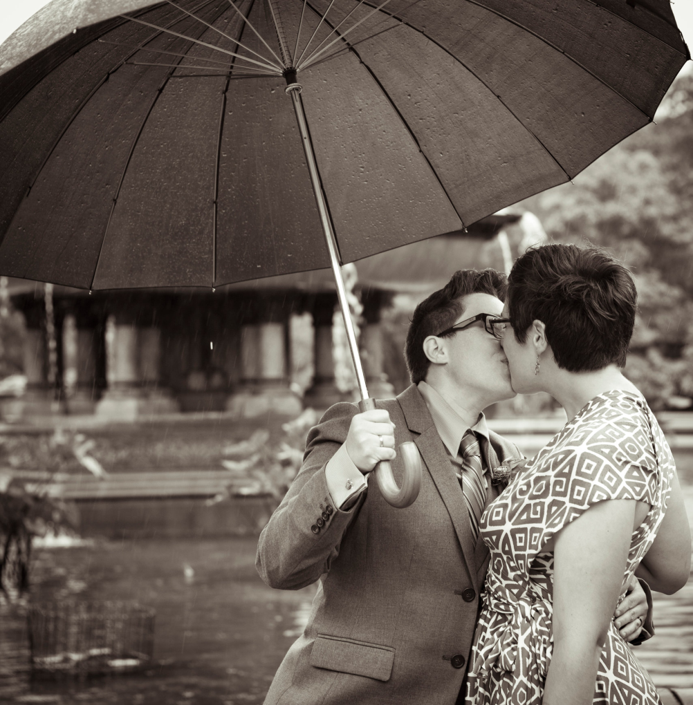Rachel and Lauren kissing in the rain after their ceremony. #queerweddings #gayweddings #wildbloomphotography #centralpark http://wildbloomphotography.com/