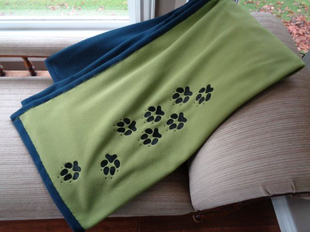 An Adult fleece blanket. Choose an embroidery design and the fleece colour for each side of the blsnket.