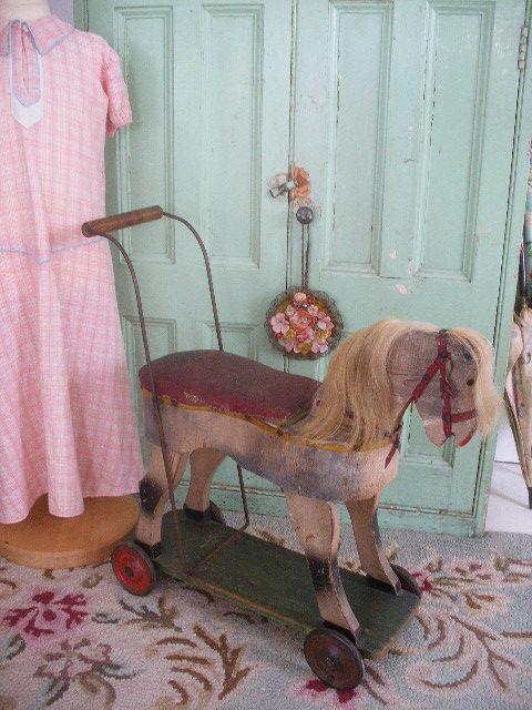 little wooden horse on wheels