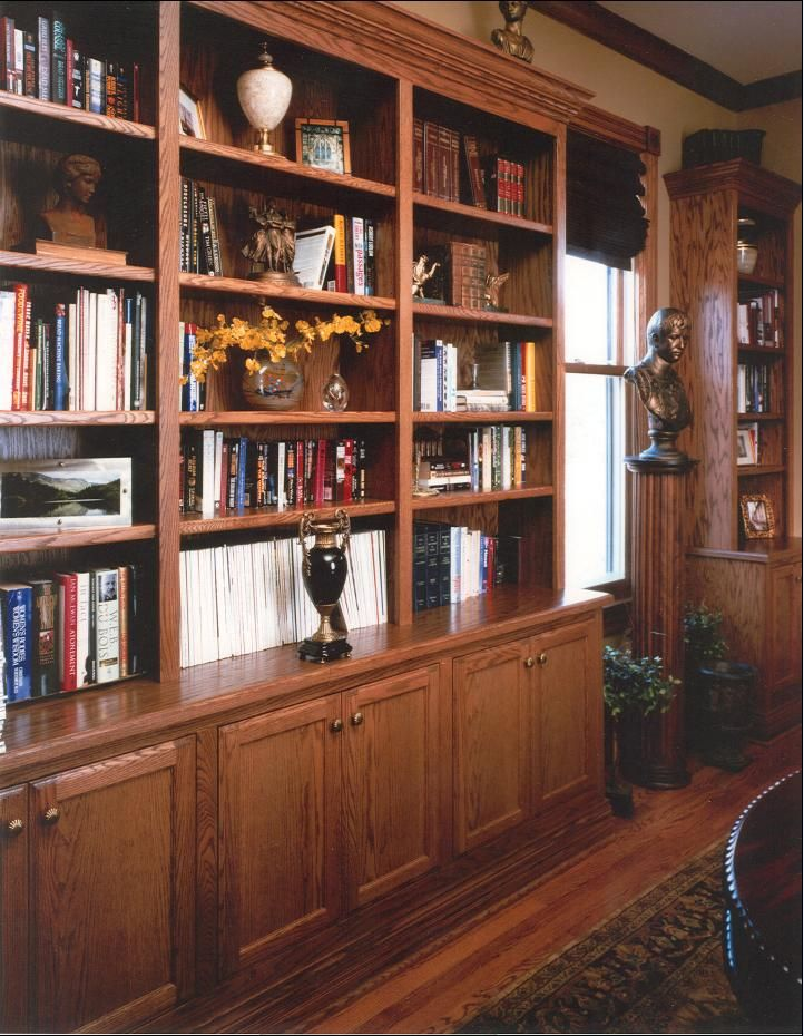 Custom Bookshelves With Cabinets Below On One Wall In Our