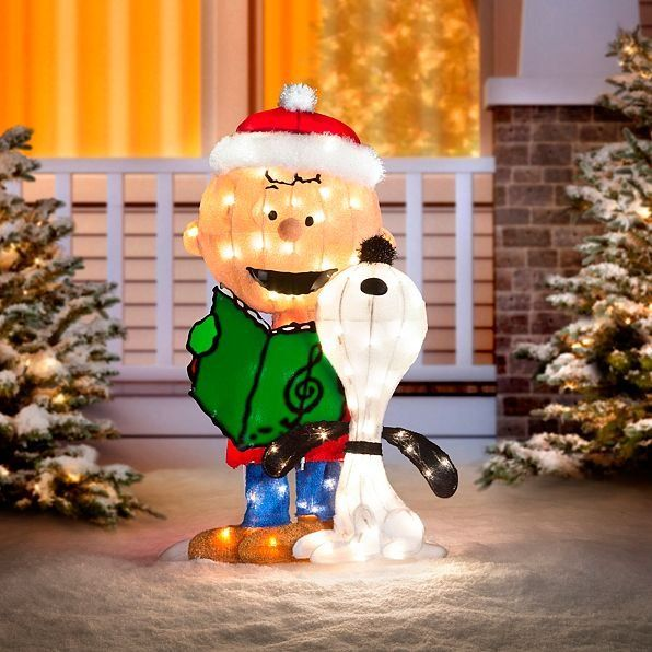 our charlie brown and snoopy caroling lighted outdoor christmas decoration sings the praises of the season this pair of buddies celebrates christmas with