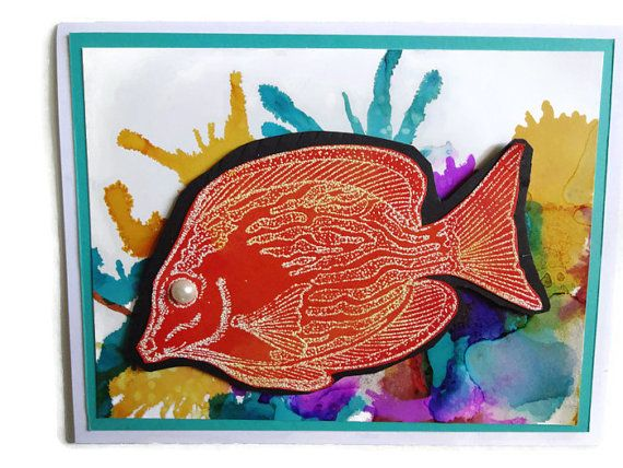 I used an alcohol ink technique to create the background for this blank greeting card. Splashes of color are added using a straw to create the