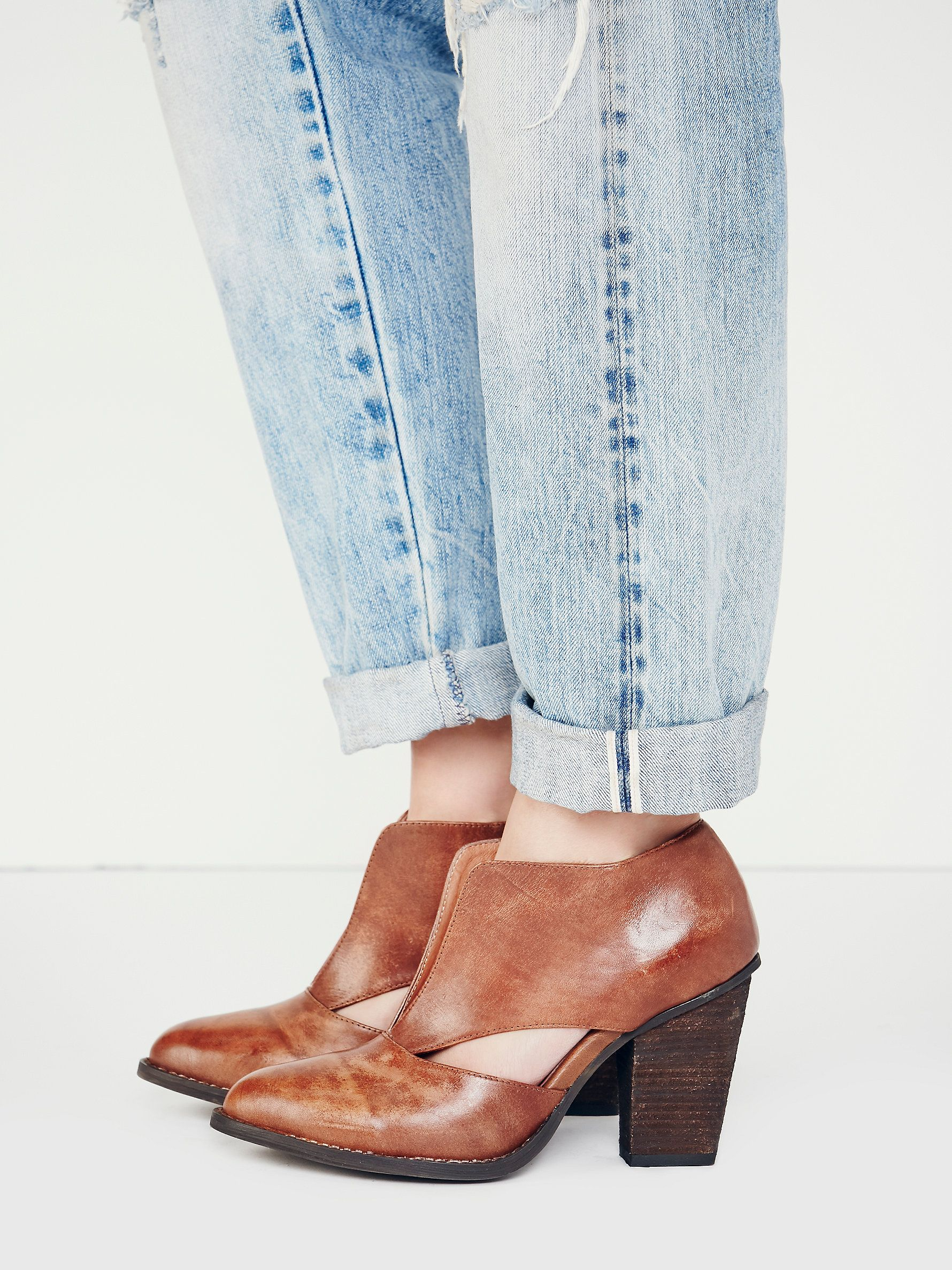 Deep V Ankle Boot   Suede deep-V heeled ankle boots with cutout detailing at each side. Rubber sole.
