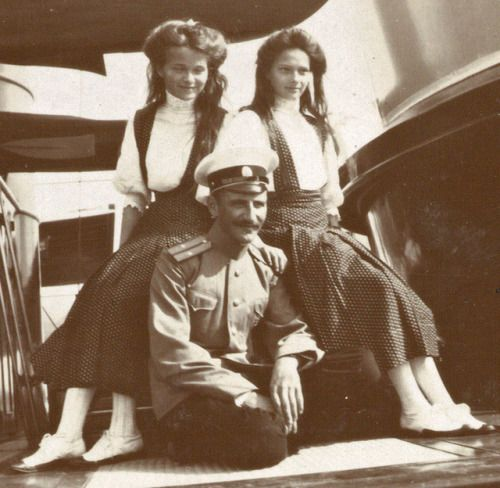 Olga Nikolaevna and Tatiana with Pavel Voronov. 1910.