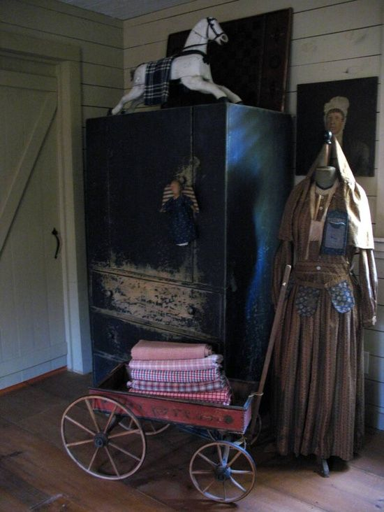 Schneeman Folk Art string of pockets around waist of skirt.