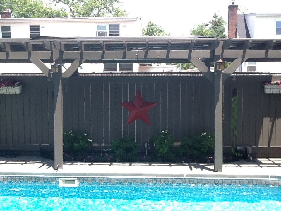 Pergola for shade and has 2 20 ft solar panels for pool for Garden pool heater