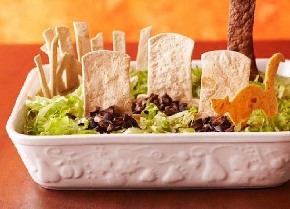 Halloween recipe ) Graveyard Taco Dip Refried beans, sour cream - halloween food decoration
