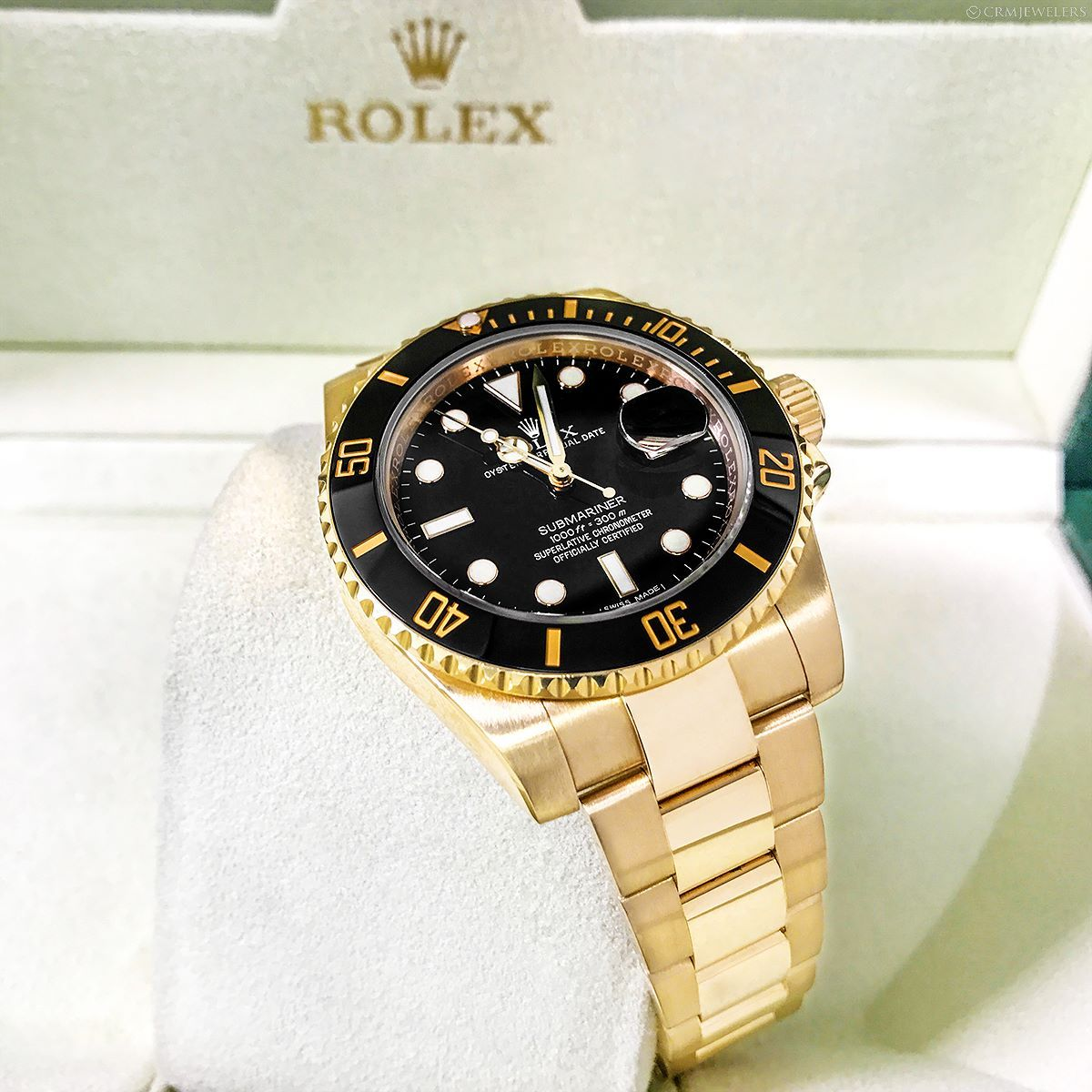 Rolex submariner yellow gold black faced dm now