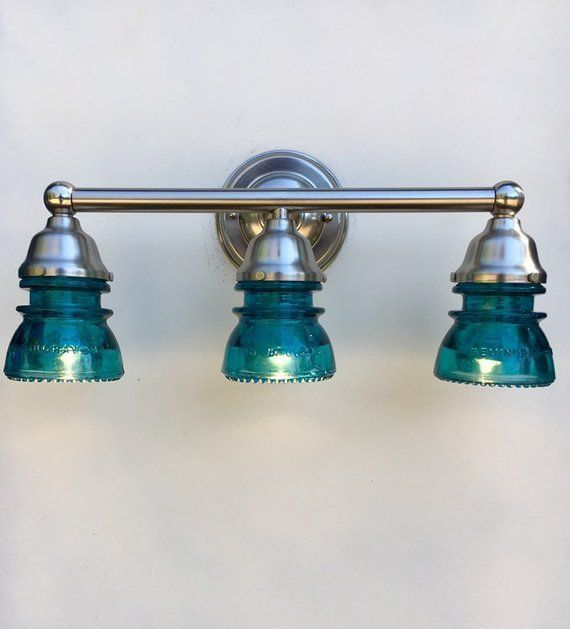 Photo of 3-light Bathroom Vanity Fixture with Deep Blue Vintage Glass Insulators with a Brushed Nickel …
