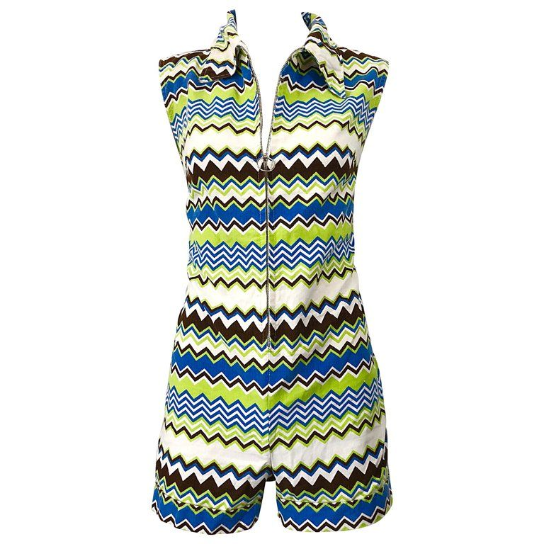 ad92252c3aa For Sale on 1stdibs - Chic early 1970s one piece romper jumpsuit! Features  zig zag prints in lime green